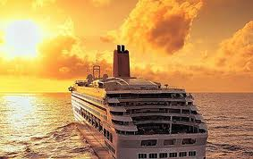 Cruise Ship into a Cloudy Sunset