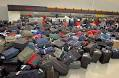 Luggage in a pile at ticket counter