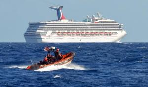 Coast Guard making way to the stranded Triumph - Photo Courtesy USCG-Reuters