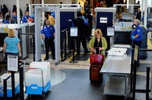 LOS ANGELES, CA - MAY 02: Transportation Security Administration (TSA) agents screen passangers at Los Angeles International Airport on May 2, 2011 in Los Angeles, California. Security presence has been escalated at airports, train stations and public places after the killing of Osama Bin Laden by the United States in Abbottabad, Pakistan. (Photo by Kevork Djansezian/Getty Images)